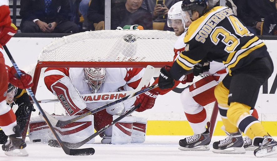The net falls on Detroit Red Wings goalie Petr Mrazek as Riley Sheahan (15) defends against Carl Soderberg (34) during the first period of a preseason NHL hockey game in Boston, Saturday, Oct. 4, 2014. (AP Photo/Michael Dwyer)