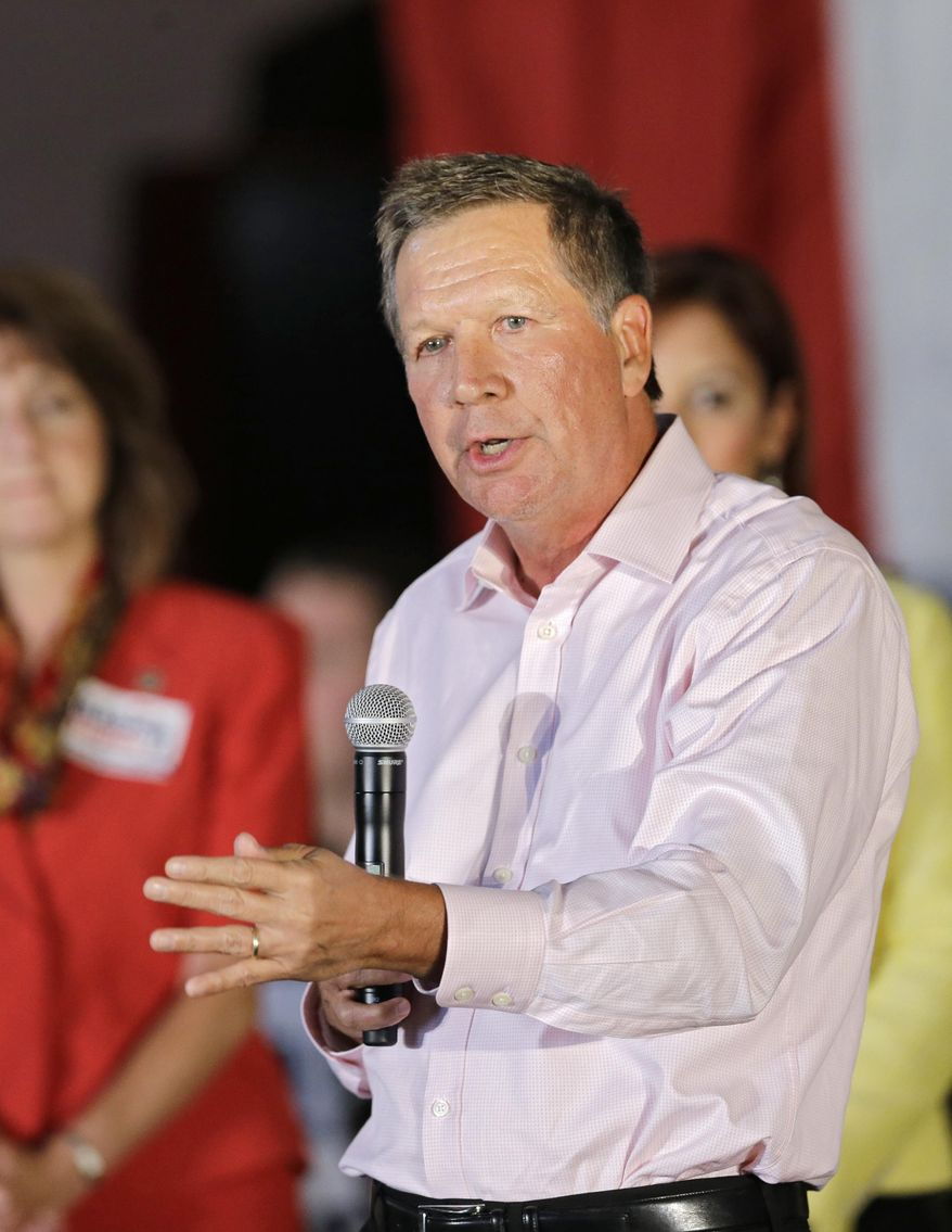 In this Sept. 29, 2014 photo, Pepublican Ohio Gov. John Kasich speaks at a Get Out the Vote rally in Independence, Ohio. Republicans who hold power in Ohio from the Kasich to the Legislature to the state's high court stand very little chance of defeat this fall, as Democrats lag in fundraising, public opinion polls and the invaluable visibility provided by incumbency. (AP Photo/Mark Duncan)