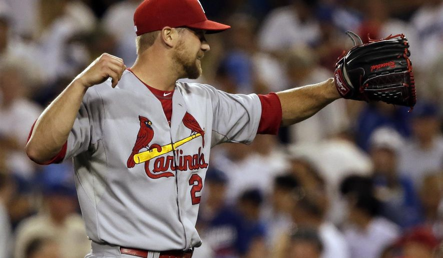 St. Louis Cardinals relief pitcher Trevor Rosenthal celebrates after his team defeated the Los Angeles Dodgers 10-9 in Game 1 of baseball's NL Division Series in Los Angeles, Friday, Oct. 3, 2014. (AP Photo/Alex Gallardo)