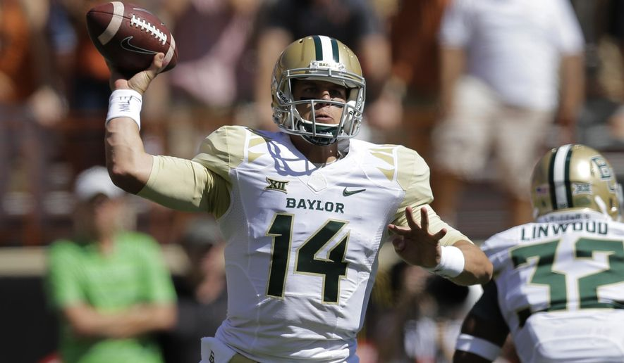 Baylor's Bryce Petty (14) passes against Texas during the first half of an NCAA college football game, Saturday, Oct. 4, 2014, in Austin, Texas. (AP Photo/Eric Gay)