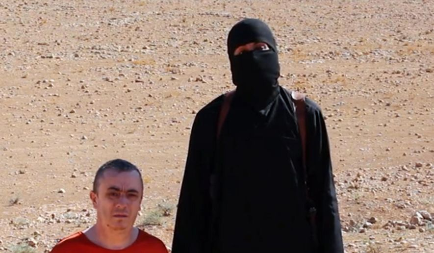 EDS NOTE: GRAPHIC CONTENT - This undated image shows a frame from a video released Friday, Oct. 3, 2014, by Islamic State militants that purports to show the killing of former taxi driver Alan Henning by the militant group. Internet video released Friday purports to show an Islamic State group fighter beheading British hostage Henning and threatening yet another American captive, the fourth such killing carried out by the extremist group now targeted in U.S.-led airstrikes.  (AP Photo) ONLINE OUT