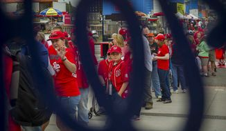 Fans wait in line for the gates to open prior to Game One of the National League Division Series as the Washington Nationals host the San Francisco Giants at Nationals Park in Washington, D.C., Friday, Oct. 3, 2014. (Photo by Rod Lamkey Jr.)