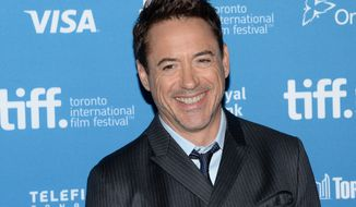 "FILE - In this Sept. 5, 2014 file photo, actor Robert Downey Jr. participates in ""The Judge"" photo call and press conference during the 2014 Toronto International Film Festival in Toronto. Downey Jr. thinks courtrooms are boring, but that didn't stop the ""The Avengers"" star from landing on the legal drama ""The Judge"" as the first project from his production company, Team Downey, which he founded with his wife, Susan. Other than the 2010 buddy comedy ""Due Date"" with Zach Galifianakis, ""The Judge"" marks the first film in five years where Downey hasn't suited up as Iron Man or Sherlock Holmes. (Photo by Evan Agostini/Invision/AP, file)"