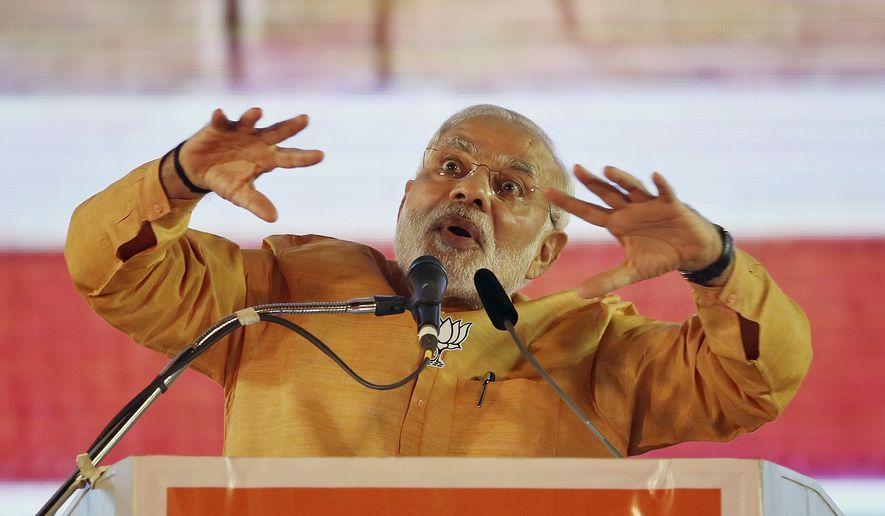 Indian Prime Minister Narendra Modi addresses a public rally ahead of Maharashtra state assembly elections in Mumbai, India, Saturday, Oct. 4, 2014. (AP Photo/Rajanish Kakade)
