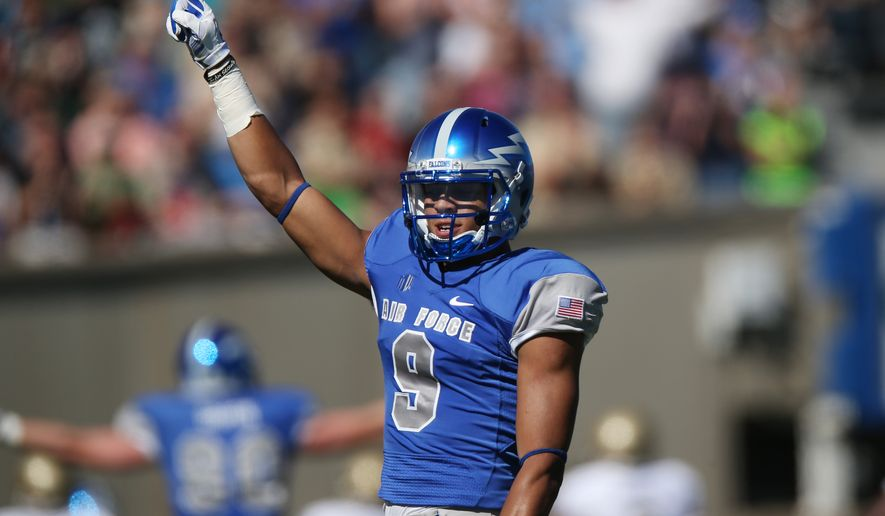 Air Force wide receiver Jalen Robinette celebrates after throwing a pass for a touchdown after fielding a lateral from quarterback Kale Pearson against Navy in the first quarter of an NCAA college football game at Air Force Academy, Colo., on Saturday, Oct. 4, 2014. (AP Photo/David Zalubowski)