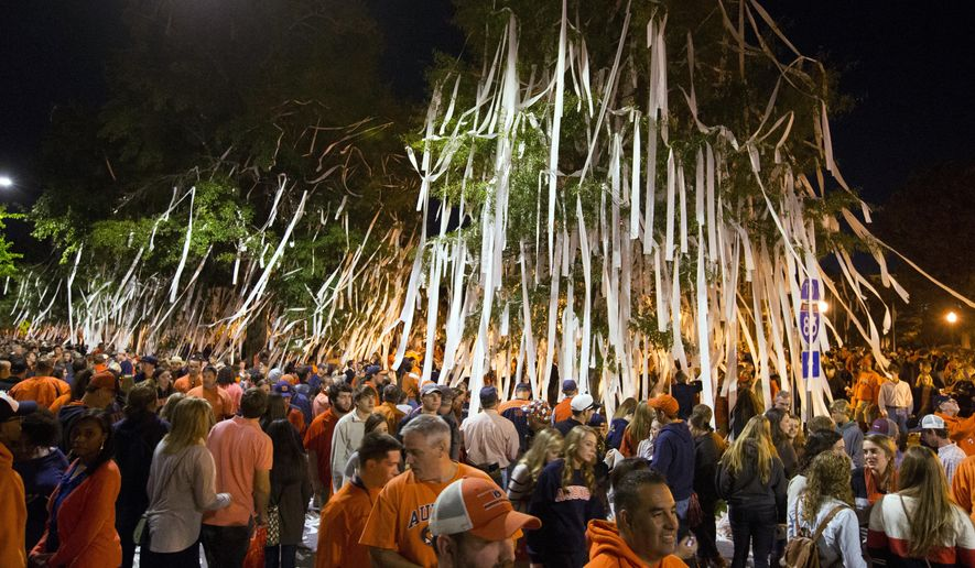 Auburn fans roll Toomer's Corner after Auburn defeated LSU 41-7 in an NCAA college football game Saturday, Oct. 4, 2014, in Auburn, Ala. (AP Photo/Butch Dill)