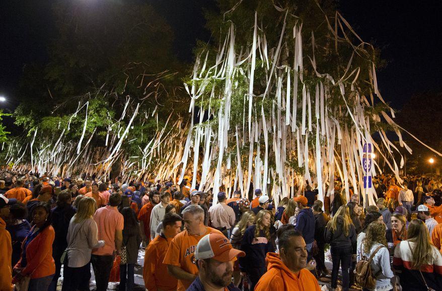 Auburn fans roll Toomer's Corner after Auburn defeated LSU 41-7 in an NCAA college football game Saturday, Oct. 4, 2014, in Auburn, Ala. (AP Photo/Butch Dill)