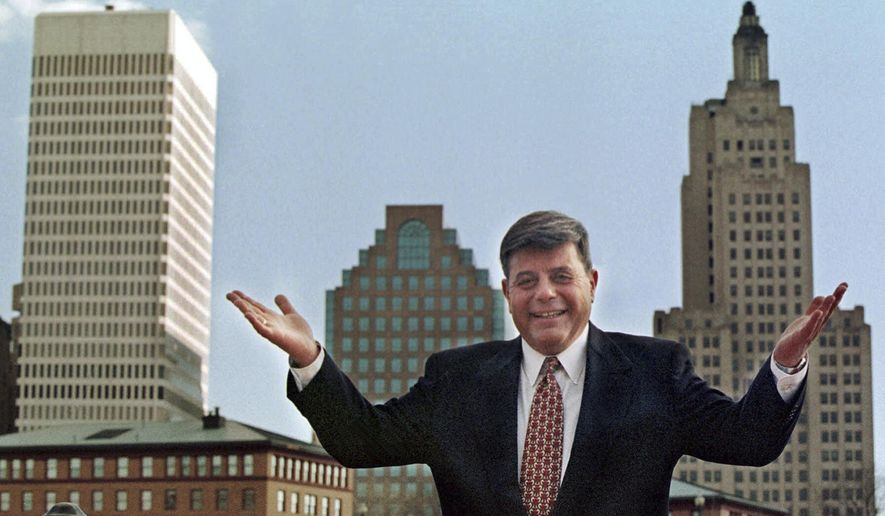 """FILE - In this October 1998 file photo, Mayor Vincent """"Buddy"""" Cianci Jr., poses along in front of the city's skyline in Providence, R.I. Cianci, who served a total of 21 years as mayor, was twice driven from office due to felony convictions. He is making another comeback bid in the Nov. 4, 2014 election. (AP Photo/Matt York, File)"""