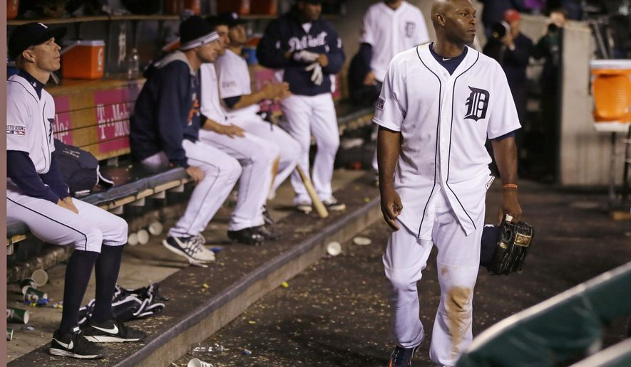 Detroit Tigers' Torii Hunter leaves the dugout after the Baltimore Orioles defeated Detroit, 2-1, in Game 3 of baseball's AL Division Series Sunday, Oct. 5, 2014, in Detroit. Baltimore won the series 3-0. (AP Photo/Carlos Osorio)