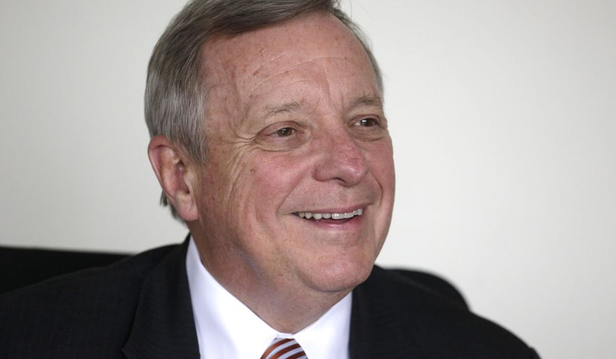 FILE - In this Sept. 12, 2014 file photo, U.S. Sen. Dick Durbin D-Ill., answers questions during an interview with The Associated Press in Chicago. Durbin is running for re-election against Illinois State Sen. Jim Oberweis R-Sugar Grove in the November general election.  (AP Photo/M. Spencer Green, File)