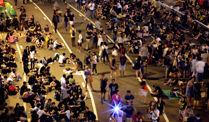 Pro-democracy protesters agreed to clear Hong Kong's streets by the beginning of the workweek. (Associated Press)