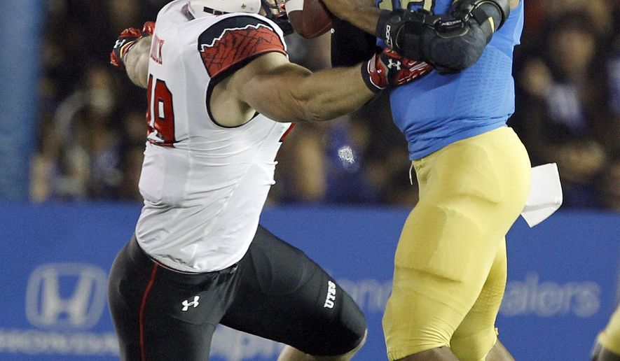UCLA quarterback Brett Hundley, right, is sacked by Utah defensive end Hunter Dimick during the first half of an NCAA college football game Saturday, Oct. 4, 2014, in Pasadena, Calif.  (AP Photo/Alex Gallardo)