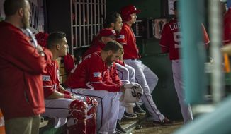 The Nationals sit in dejection in the bottom of the 18th inning during Game 2 of the National League Division Series as the Washington Nationals host the San Francisco Giants at Nationals Park in Washington, DC., Saturday, October 4, 2014. (Photo by Rod Lamkey Jr.)