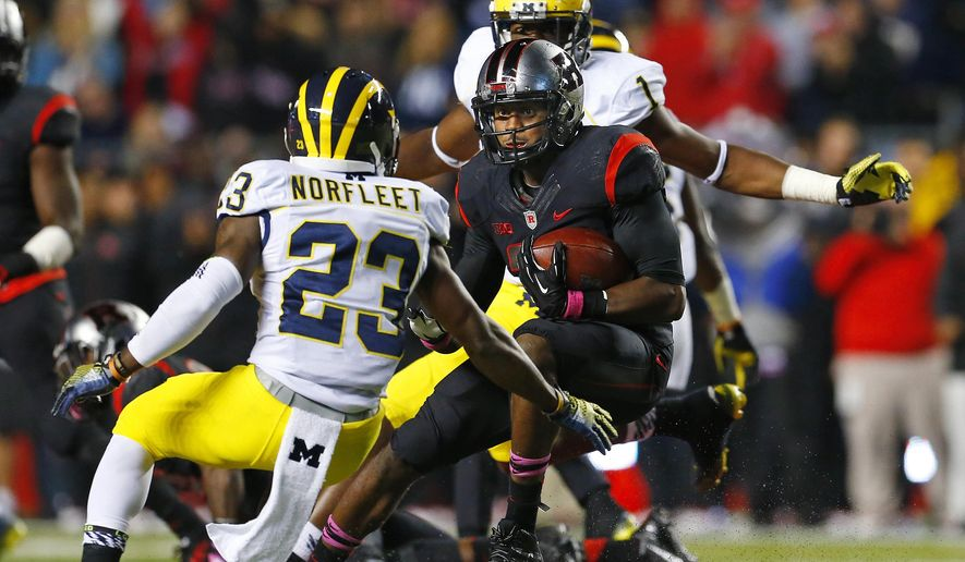 Rutgers defensive back Davon Jacobs (29) looks to get past Michigan's Dennis Norfleet (23) after Jacobs intercepted a pass during the second half of an NCAA college football game Saturday, Oct. 4, 2014, in Piscataway, N.J. Rutgers defeated Michigan 26-24. (AP Photo/Rich Schultz)