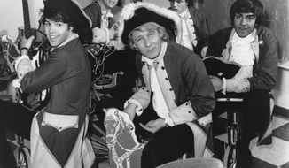 In a July 1967 file photo, Paul Revere, front, and the Raiders are seen in character. Paul Revere, born Paul Revere Dick, the organist and leader of the Raiders rock band, died Saturday, Oct. 4, 2014 at his home in Idaho, says Revere's manager Roger Hart. He was 76. (AP Photo, File)