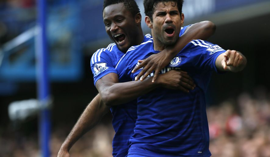 Chelsea's Diego Costa celebrates after scoring his sides second goal of the game during their English Premier League soccer match between Chelsea and Arsenal at Stamford Bridge stadium in London Sunday, Oct. 5, 2014. (AP Photo/Alastair Grant)