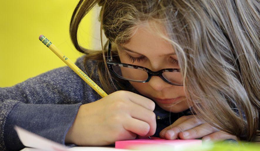Christmas gift conundrum: What do you get your children's teachers? (AP Photo/Elaine Thompson)