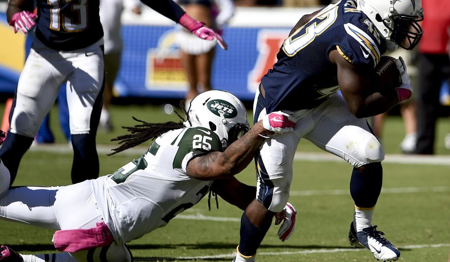 San Diego Chargers running back Branden Oliver, right, scores past New York Jets free safety Calvin Pryor during the first half of an NFL football game, Sunday, Oct. 5, 2014, in San Diego. (AP Photo/Denis Poroy)