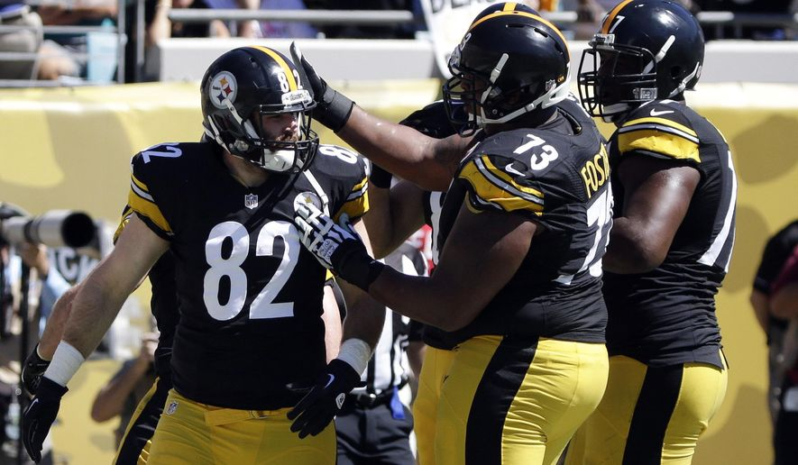Pittsburgh Steelers tight end Michael Palmer (82) celebrates with teammates, including Ramon Foster (73), after scoring a touchdown against the Jacksonville Jaguars during the first half of an NFL football game in Jacksonville, Fla., Sunday, Oct. 5, 2014. (AP Photo/Stephen B. Morton)