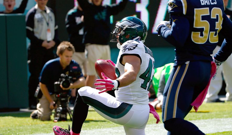 Philadelphia Eagles' Chris Maragos, left, celebrates past St. Louis Rams' Daren Bates after scoring a touchdown after recovering a blocked punt during the first half of an NFL football game, Sunday, Oct. 5, 2014, in Philadelphia. (AP Photo/Matt Rourke)
