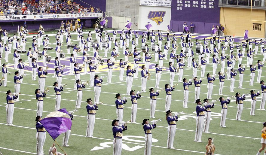 ADVANCE FOR USE SUNDAY, OCT. 5 - In this photo taken on Saturday, Sept. 27, 2014, the University of Northern Iowa Panther Marching Band performs before an NCAA football game in Cedar Falls, Iowa. Howard Barnes is in his 10th year as the announcer for the marching band, and he has nothing but good things to say about the program. He has seen band membership swell to 330 members this year, the most in UNI history.  (AP Photo/Waterloo Courier,  Courtney Collins)