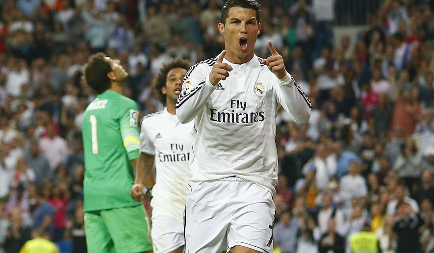 Real's Cristiano Ronaldo, foreground celebrates his goal during a Spanish La Liga soccer match between Real Madrid and Athletic Bilbao at the Santiago Bernabeu stadium in Madrid, Spain, Sunday, Oct. 5, 2014. (AP Photo/Andres Kudacki)
