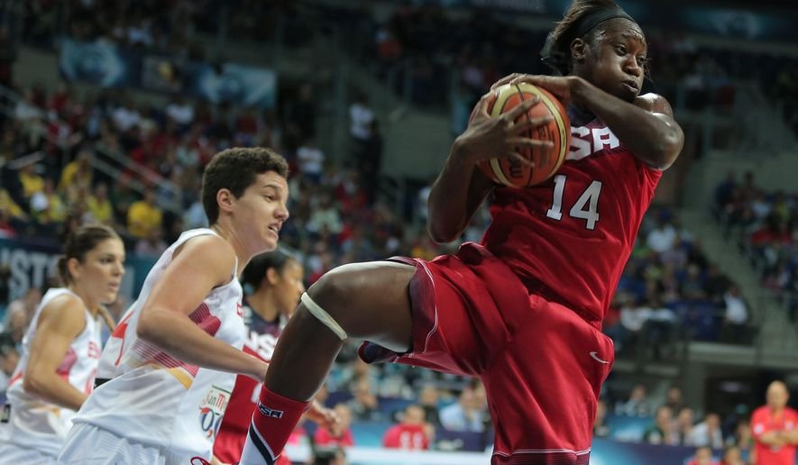 Tina Charles of US, right,  tries takes control of the ball , during the Basketball  World Championship for Women's final against Spain, at Fenerbahce Arena in Istanbul, Turkey, Sunday, Oct. 5, 2014. (AP Photo)