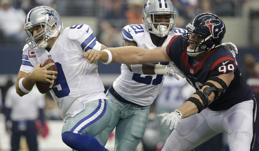 Dallas Cowboys' Tony Romo (9) is unable to escape being sacked by Houston Texans' J.J. Watt (99) as cornerback Orlando Scandrick (32) helps against the pressure during the first half of an NFL football game, Sunday, Oct. 5, 2014, in Arlington, Texas. (AP Photo/Tim Sharp)