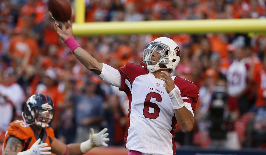 Arizona Cardinals quarterback Logan Thomas (6) throws against  the Denver Broncos during the second half of an NFL football game, Sunday, Oct. 5, 2014, in Denver. The Broncos won 41-20. (AP Photo/Joe Mahoney)