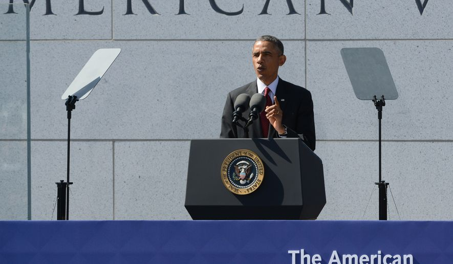 U.S. President Barack Obama speaks during the dedication ceremony for the American Veterans Disabled for Life Memorial in Washington, Sunday, Oct. 5, 2014. (AP Photo/Molly Riley)