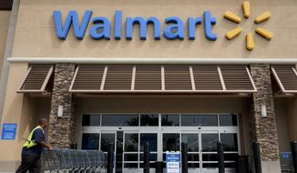 A 2-year-old boy accidentally shot and killed a woman he was shopping with in an Idaho Wal-Mart Tuesday.  (AP Photo/Jae C. Hong, File)