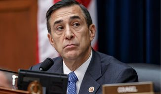 Rep. Darrell Issa, questioned whether IRS employee Takisha McGee lost track of investigative records containing sensitive taxpayer information. - Associated Press