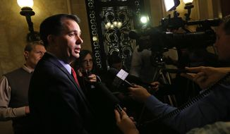Wisconsin Gov. Scott Walker speaks to members of the media at the Wisconsin State Capitol building in Madison, Wis. following United States Supreme Court rejection of appeals by Wisconsin and four other states seeking to prohibit same-sex marriages, Monday, Oct. 6, 2014. (AP Photo/Wisconsin State Journal, John Hart)