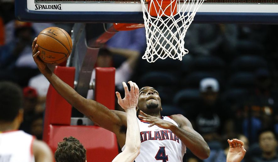 Atlanta Hawks forward Paul Millsap (4) goes up for a basket in the first half of an preseason NBA basketball game against the New Orleans Pelicans Monday, Oct. 6, 2014, in Atlanta.  (AP Photo/John Bazemore)