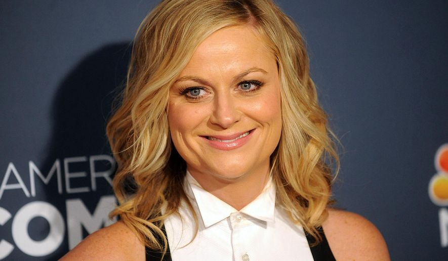 """In this April 26, 2014 file photo, actress Amy Poehler attends the American Comedy Awards in New York.  Poehler's memoir, """"Yes Please,"""" will be released on Oct. 28. (Photo by Brad Barket/Invision/AP, File)"""