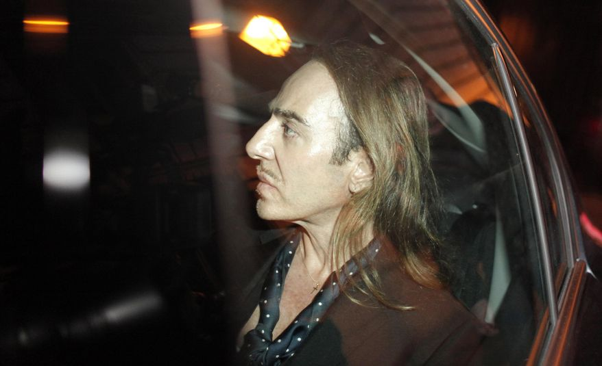 """FILE - in this June 22, 2011 file photo, former Dior designer John Galliano leaves the Paris court house, charged with hurling anti-Semitic slurs in a Paris cafe. Galliano will be designing fashion again, joining Paris house Martin Margiela, three years after leaving the business in disgrace. Maison Martin Margiela's parent company OTB announced in a statement Monday, Oct.6, 2014 that they're bringing Galliano on board as creative director, praising his """"non-conformist creative talent."""" (AP Photo/Thibault Camus, File)"""