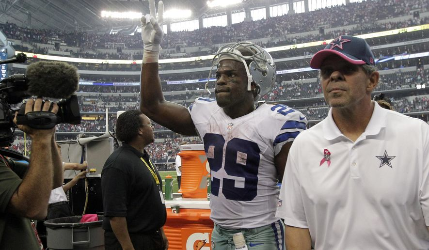 Dallas Cowboys' DeMarco Murray (29) acknowledges cheers from fans as he walks off the field following their NFL football game against the Houston Texans, Sunday, Oct. 5, 2014, in Arlington, Texas. The Cowboys won in overtime 20-17. (AP Photo/Tim Sharp)