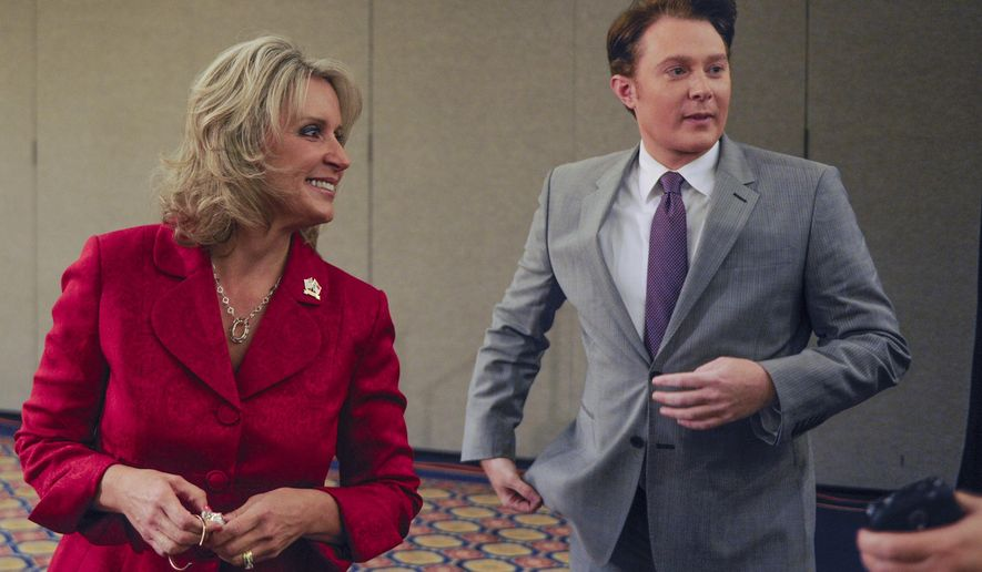 The candidates in the 2nd Congressional District race,  Clay Aiken, right, and Renee Ellmers, leave the stage after the taping of a debate on Monday, Oct. 6, 2014 at the Pinehurst Resort in Pinehurst, N.C. (AP Photo/The Fayetteville Observer, Raul R. Rubiera) ** FILE **