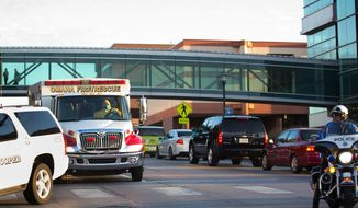 An ambulance transports Ashoka Mukpo, who contracted Ebola while working in Liberia, to the Nebraska Medical Center's specialized isolation unit Monday, Oct 6, 2014 in Omaha, Neb., where he will be treated for the deadly disease. Mukpo is an American video journalist who was working in Liberia as a freelance cameraman for NBC News when he became ill last week. (AP Photo/Omaha World-Herald, Ryan Soderlin) MAGS OUT TV OUT