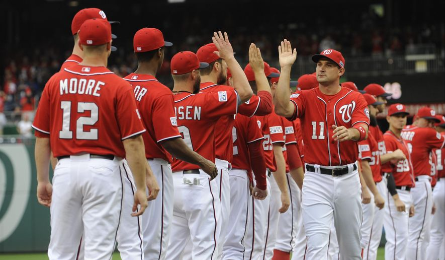 Washington Nationals left fielder Ryan Zimmerman (11) greets teammates during team introductions before Game 1 of baseball's NL Division Series against the San Francisco Giants at Nationals Park in Washington, Friday, Oct. 3, 2014. (AP Photo/Toni L. Sandys, Pool)