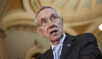In this Sept. 16, 2014, file photo, Senate Majority Leader Harry Reid, D-Nev., speaks with reporters following a Democratic policy lunch at the Capitol in Washington. Lawyers for a former lobbyist are going before a federal appeals court in San Francisco, on Monday, Oct. 6, 2014, to try to overturn his conviction for carrying out a scheme to raise money illegally for Reid. (AP Photo/J. Scott Applewhite, File)