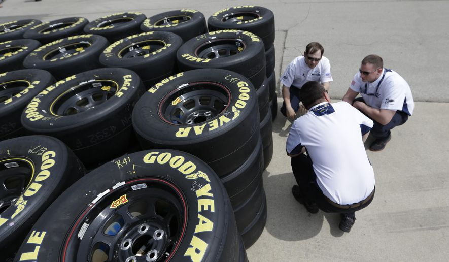 FILE - In this April 3, 2014, file photo, Goodyear tire technical officials, whom did not which to be identified, discuss tires at the Texas Motor Speedway in Fort Worth, Texas. Three NASCAR championship contenders had tire problems in Sunday's Oct. 5, 2014, Sprint Cup Series race at Kansas Speedway. (AP Photo/LM Otero, File)