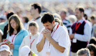 The 25th annual East of the River Revival starts Monday, offering four days of faith-based events for the young and old hoping to reconnect with their religion. In this 2011 file photo, people pray at a Mass with then-Pope Benedict XVI and about 100.000 believers at the airfield in Freiburg, Germany. (AP Photo/Martin Meissner) ** FILE **
