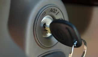 FILE - This Tuesday, April 1, 2014, file photo, shows a key in the ignition switch of a 2005 Chevrolet Cobalt in Alexandria, Va. Despite recall notices, thousands of news stories, highly publicized congressional hearings and two federal investigations, fewer than half of the roughly 2.36 million people still driving Chevy Cobalts, Saturn Ions and other small cars with defective and potentially deadly ignition switches have had them replaced. (AP Photo/Molly Riley, File)