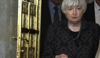 Federal Reserve Chair Janet Yellen arrives for an open session of the Financial Stability Oversight Council meeting at the Treasury Department in Washington, Monday, Oct. 6, 2014. (AP Photo/Susan Walsh)