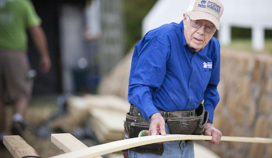 "Former President Jimmy Carter kicks off construction for Habitat for Humanity's 31st annual ""Jimmy & Rosalynn Carter Work Project."" More than 5,000 volunteers will join the Carters to help build or repair more than 100 homes in North Texas this week. (PRNewsFoto/Habitat for Humanity Intl) ** FILE **"