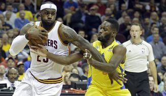 Cleveland Cavaliers' LeBron James (23) drives past Maccabi Tel Aviv's Jeremy Pargo in the first quarter of a preseason exhibition basketball game Sunday, Oct. 5, 2014, in Cleveland. (AP Photo/Mark Duncan)