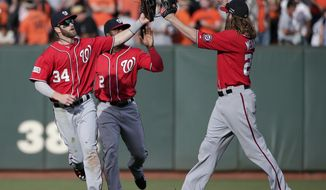 Washington Nationals Bryce Harper, left, Denard Span and Jayson Werth, right, celebrate after they beat the San Francisco Giants 4-1 during Game 3 of baseball's NL Division Series in San Francisco, Monday, Oct. 6, 2014. (AP Photo/Marcio Jose Sanchez)
