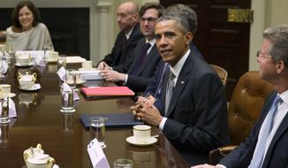 President Obama meets with financial regulators for a discussion on the economy and to receive an update on implementation of Wall Street Reform on Monday, Oct. 6, 2014, in the Roosevelt Room of the White House in Washington. (AP Photo/Evan Vucci)