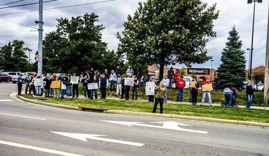 About 40 gun-toting demonstrators gathered in front of the Beavercreek, Ohio, Walmart to protest the Aug. 5 police shooting of 22-year-old John Crawford III. (Twitter/@guncultureworld)